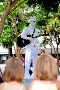 "The ""White Man"" plays to a young audience at the Farmer's Market in Charleston."