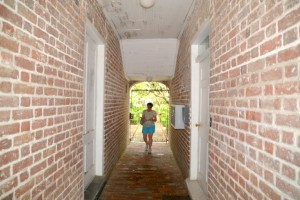 Walking down one of Charleston's many narrow walkway.