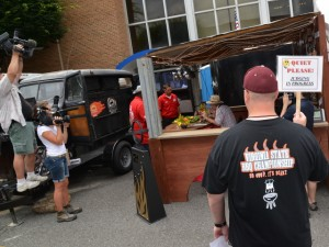 Television crews follow one of the competitors in the Virginia State Barbeque Championship at Galax, Va.