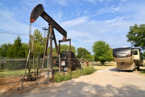 A working oil field pumping unit on the grounds of a campground in Enid, OK.
