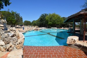 The lodge area provides guests with overnight facilities including a lounge and pool at YO Ranch.