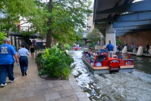 Tourist take a ride on a boat on the San Antonio River at River Walk in the city's downtown area.
