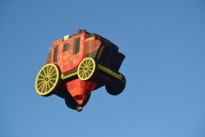 A stage coach takes to the sky during Special Shape Rodeo.