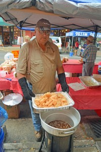 Showing off a fresh basket of fried pork rhinds at one of the vendor booths at the Galax Smoke on the Mountain BBQ Championship.