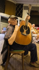 """""""Jack"""" shows off his well-used 1950's era Martin D28 guitar at the Thursday Night Jam Session in Fries, VA."""