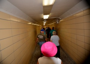 Visitors at the dam are taken down a long corridor deep inside the facility when touring the power plant section.