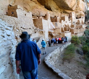 Visitors enter the Cliff Palace along a narrow trail on the side of the mountain.