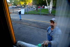 Windows get a last minute cleaning before the train leaves the station at Durango.