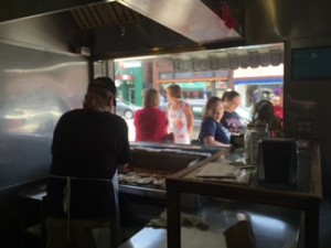 Having a pork chop sandwich at Snappy's in Andy Griffith's hometown of Mount Airy, NC. Customers are lined up on the street and looking through a window at a chef grilling pork chops. The small restaurant became famous when it was mentioned once on Griffith's television show.
