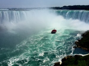 Maid of the Mist approaches the Horseshoe Falls with a boatload of tourists.