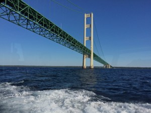 The ferry connecting tourist between the Michigan mainland and Mackinac Island, takes a close up look underneath Mackinaw Bridge,.