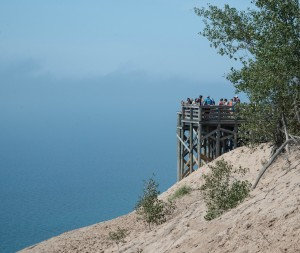 From 450 feet above the waters of Lake Michigan, visitors to Sleeping Bear Dunes get an unspoiled view of the water and the dunes.