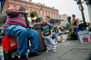 A youngster gets a picture with a brass band playing dixieland at Cafe du Monde.