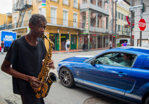Making music fr tips off Bourbon Street in the French Quarter.