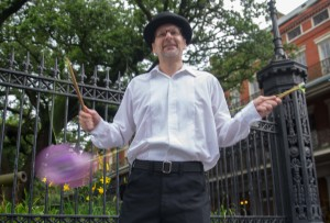 A street vendor shows his skills with a ball and string in Jackson Square.