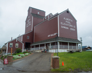 The Dawson Creek Visitor's Center is found within the original 1931 Northern Alberta Railway Station Museum, the Visitor Center along with the Alaska Highway Mile O sign. The visitor's center offers RV paved parking and is where and Grain Elevator Art Gallery, shown above.
