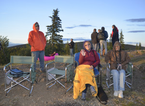 Trying to keep warm on top of Mount Dome on Summer Solstice day in Dawson City, Yukon Territory,Canada.