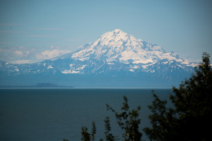 Redoubt Mountain, an active volcano, is located across Cook Inlet from Kenai, AK.