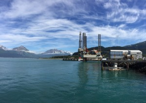 An offshore drilling rigs is parked in a repair facility at Seward, AK.