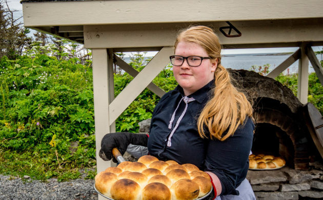 Baking bread in a traditional wood fired stone oven in Newfoundland